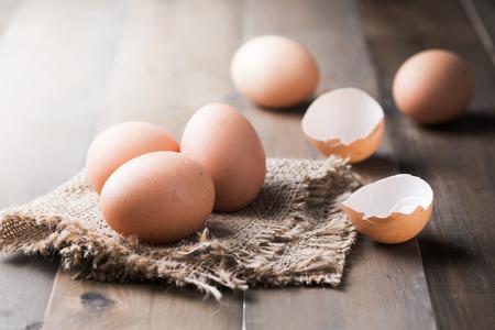 raw fresh egg on sack and wood background.