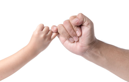 father and daughter  hand making promise as a friendship concept isolated on white background.. Stock Photo