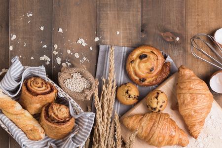 Homemade breads or bun on wood background, croissant puff cinnamon, breakfast food.