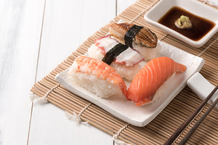 sushi with sauce and wasabi on wood plate, Japanese food. Stock Photo