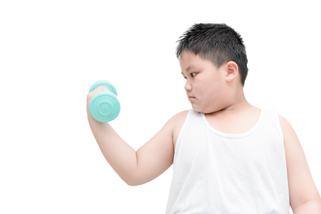 obese fat boy is doing exercises with dumbbells; isolated on white background with copy space.