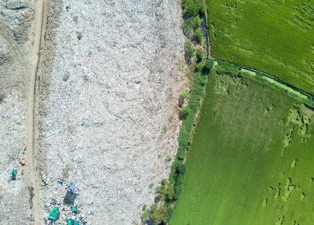 aerial view from drone: garbage in Municipal landfill for household waste with paddy field, pollution problem Stock Photo