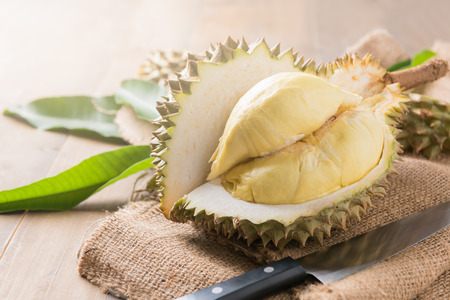 fresh durian on sack, king of fruit in thailand. Stock Photo - 79107219