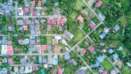Aerial photo from drone: neighborhood with residential houses and driveways, land use planning concept..