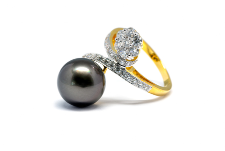 diamond ring: Closed up dark pearl with diamond and gold ring isolated on white background, wedding ring and love concept