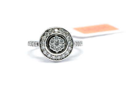 caras emociones: beautiful Platinum ring with diamond isolated on white background, wedding ring and love concept.