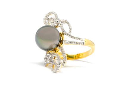expensive: Closed up dark pearl with diamond and gold ring isolated on white background, wedding ring and love concept
