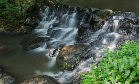 small waterfall in the evergreen forest, Sam lan waterfall, Nation park in Thailand.