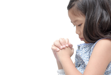 asian cute girl praying isolated over white background. asian girl hand praying, Hands folded in prayer concept for faith, spirituality and religion