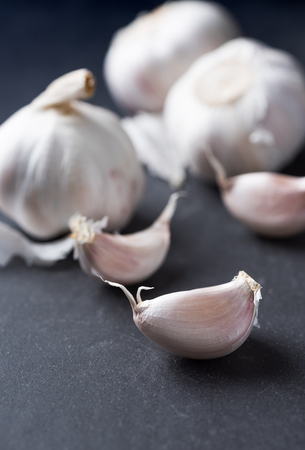 spiciness: white garlic on black background, Most ingredient for cook thai food. Stock Photo
