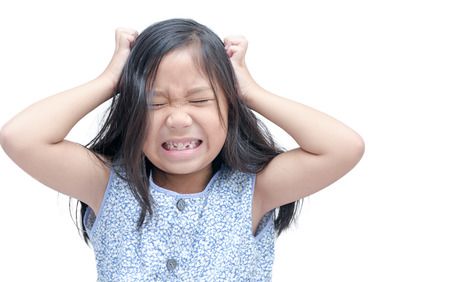 girl itchy his hair on isolated white background. Foto de archivo