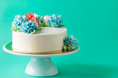cute cake on cake stand on light green background.