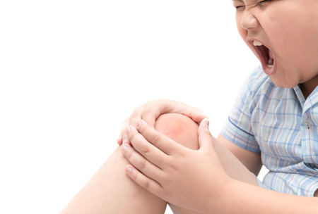 Obese fat boy suffering from knee pain isolated on white background, Healthy problem