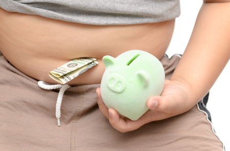 American dollars or US dollars with big belly boy and holding piggy bank on hand isolated on white, saving money concept.