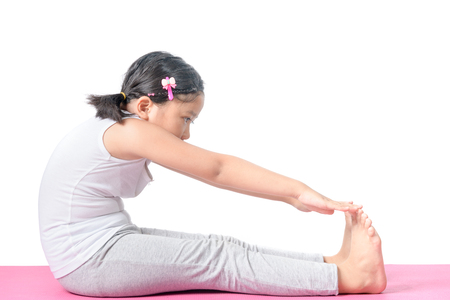 Haealthy asian kid exercise on yoga mat isolated on white background, leisure and lifestyle concept..