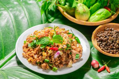 Spicy minced pork mix Zanthoxylum rhetsa with fresh vegetables, Northern food of Thailand