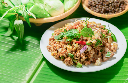 Spicy minced pork mix Zanthoxylum rhetsa with fresh vegetables, Northern food of Thailand.