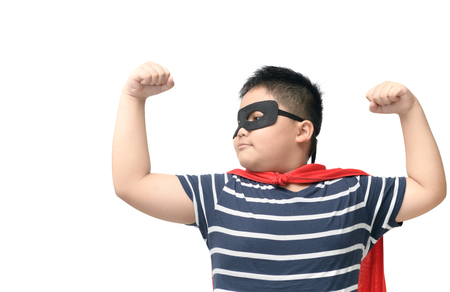 Fat child plays superhero isolated on white background, Strong and power concept..
