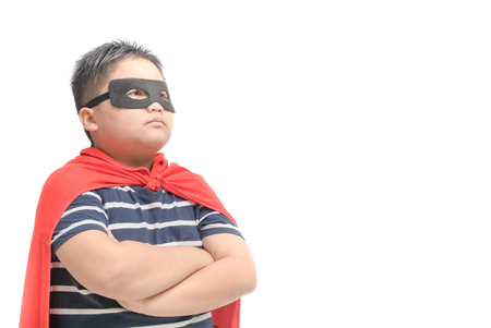 Fat child plays superhero isolated on white background, Boy power concept..