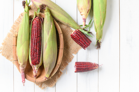 Siam Ruby Queen Corn on wood background with copy space, Can be eaten fresh. The taste is sweet and crisp.