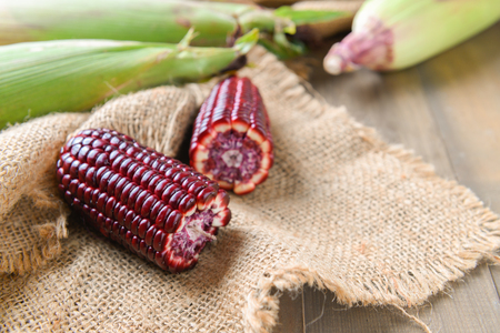 Siam Ruby Queen Corn on wood background, Can be eaten fresh. The taste is sweet and crisp.