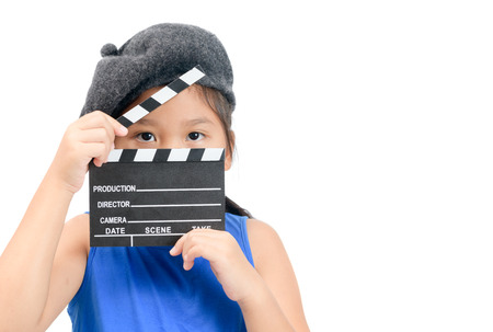 Kid Director holding clapper board or slate film for making video cinema isolated on white background and copy space. Movie and cinema concept
