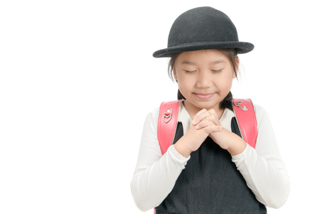 Asian girl praying isolated on white background. student asia hand pray. press the hands together at the chest or forehead in sign of respect. Faith spirituality and religion concept