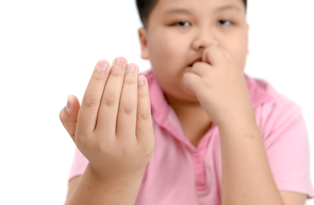Disgusting bitten fingernails on boy's hand isolated on white background, Chronic Onychophagia.. Stock Photo