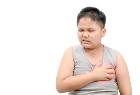 Obese fat boy clutching his chest from acute pain isolated on white background. Heart attack symptom-Healthcare and medical concept