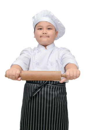 Asian boy chef in uniform cook holding rolling pin isolated on white