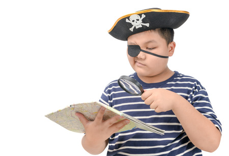 Fat pirate using magnifying glass to view the map isolated on white