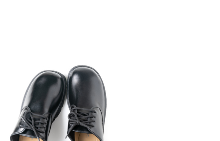 New leather student shoes isolated on white background, prepare for back to school concept and top view with copy space.