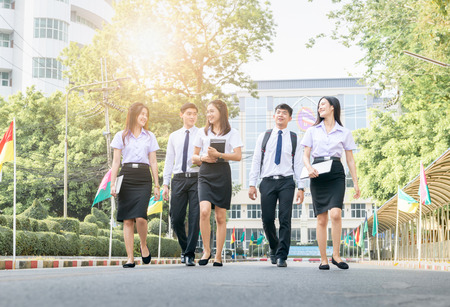 Happy and smart student walking on road at university, Education and back to school concept