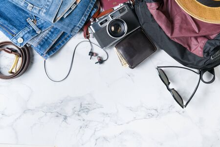 prepare backpack accessories and travel items on marble background with copy space, flat lay, top view background. Archivio Fotografico - 131888282