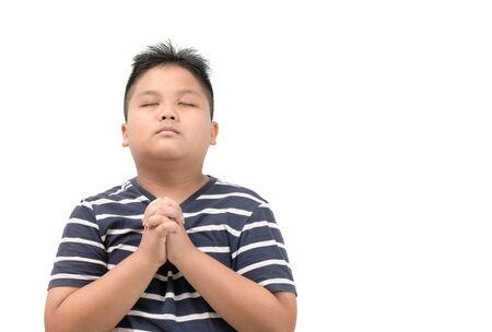 Asian boy praying isolated on white