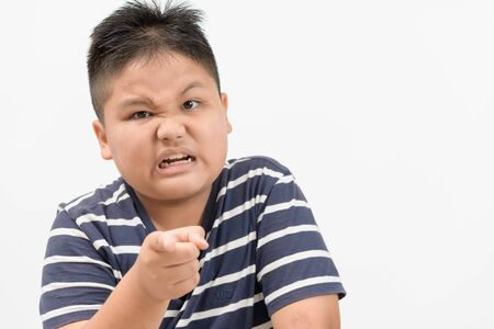 Portrait of a angry obese boy isolated on white