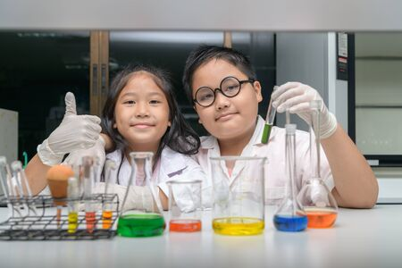 Happy two children making science experiments. Science and Education concept