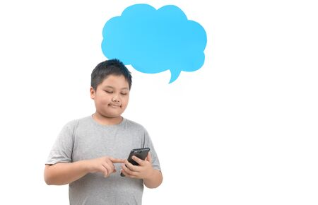 Obese fat boy play smartphone with empty blue speech bubble isolated on white background, advertising concept.