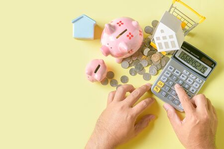 Business man use calculators to calculate And analyze financial expenses.