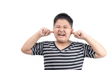 Obese fat boy covering ears ignoring annoying loud noise isolated on white background, plugs ears to avoid hearing sound.
