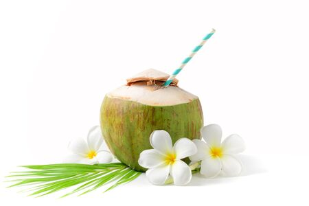 Fresh coconut drink with plumeria flower and paper straw isolated on white