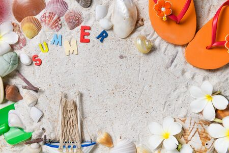 Colorful summer text with oraneg sandal, sea shells and plumeria flowers on sand Фото со стока