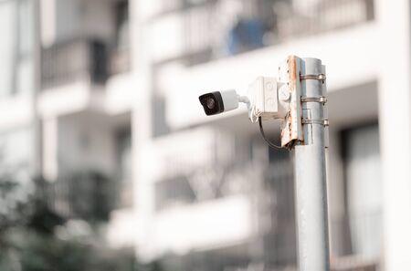 Security CCTV camera on pole in condominium building, Security camera concept