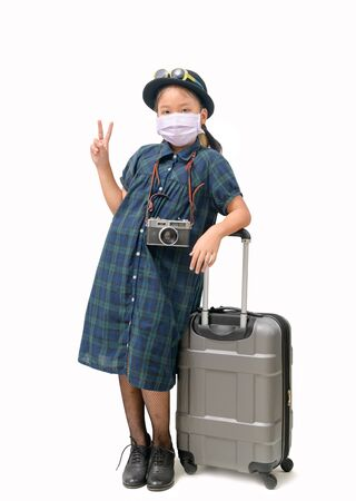 Child traveler wear surgical mask with suitcase isolated on white Stock Photo