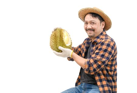Happy farmer is carrying durian and smiling isolated on white background. Because it can be sold at a very good price in the market, King of fruits and summer fruits in Thailand