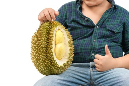 Belly fat boy holding durian isolated on white background, Durian is a fruit that is high in sugar and is also rich in fat. This fruit is therefore not suitable for obese and diabetic people