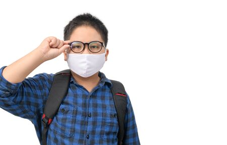 A high school boy student wear mask and eye glasses carrying backpack isolated on white background, back to school new normal concept