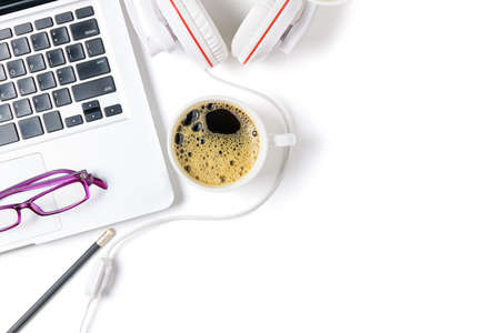 Laptop and headphone with black coffee isolated on white background, top view and copy space