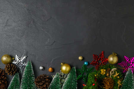 Christmas background with decorations on black stone table background, Xmas and Happy New Year composition. Flat lay, top view Stock Photo