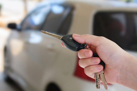 women's hand: womens hand presses on the remote control car alarm systems Stock Photo